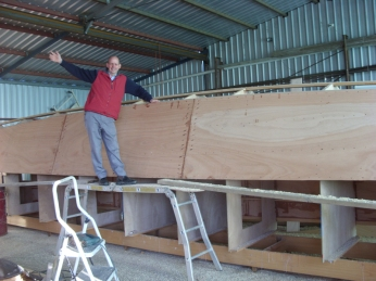 One happy boat builder. Chris has just finished sheeting a hull.