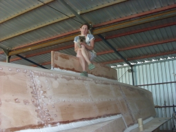 Michelle on top of the hull. Every hole has been bogged.