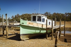 A nice traditional fishing boat sitting on the mud at low tide
