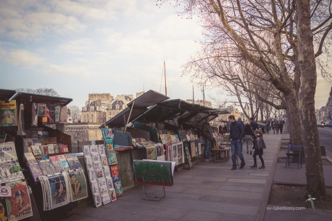 Bouquinistes along the Left Bank of the Seine River sell old books and etchings, as well as souvenirs