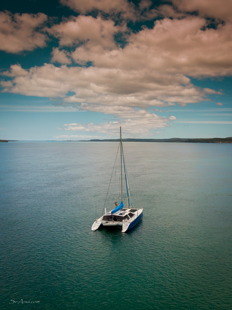 Anui anchored off White Cliffs, Fraser Island